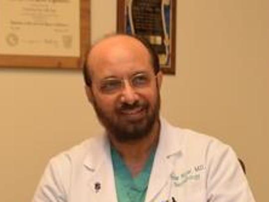 Dr. Amar Nijjar, a pioneering neonatologist, discusses his career recently in his office.