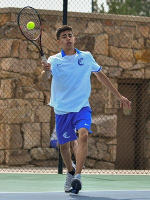 Pueblo Central's Christian Guzman returns a serve against Pueblo West's Brendan Bradfield in the No. 1 singles semifinals of the Region 7 tournament Thursday, Sept. 17, 2020, at Pueblo City Park.