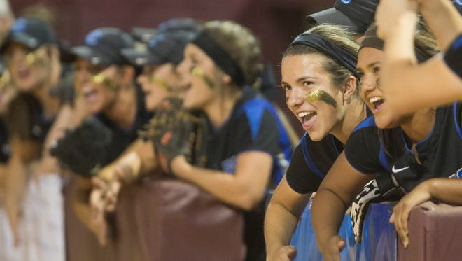 Sandra Day O'Connor's dugout cheers on their batter against Mountain Ridge during the 2015 Div. I State Softball Championship at Farrington Softball Stadium in Tempe.