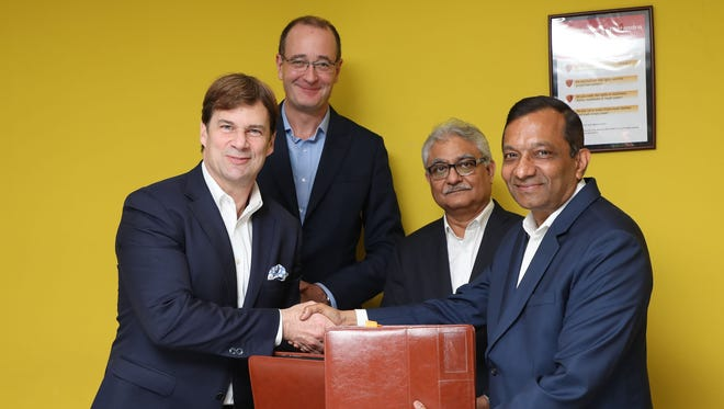 From left to right: Jim Farley, Ford executive vice president and president of Global Markets, Peter Fleet, Group vice president & president, Ford Asia Pacific with Rajan Wadhera, president, automotive sector and Pawan Goenka, Managing Director, Mahindra and Mahindra Ltd. The two companies will jointly develop new SUVs, and a small electric vehicle as part of several initiatives it was announced March 22, 2018.