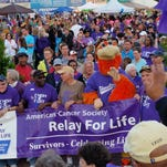 Cancer survivors and their caretakers line up for the beginning lap of Relay for Life of Wicomico County, at Arthur W. Perdue Stadium.