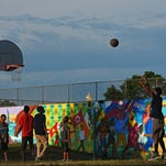 A group of boys play basketball at Meldrum Park Tuesday, July 26, 2016, in Sioux Falls. Kids in the group said they play at the park often.