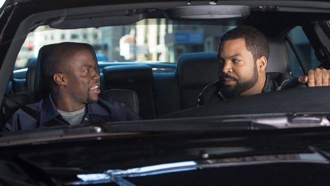 "Ice Cube, right, and Kevin Hart in a scene from ""Ride Along."""