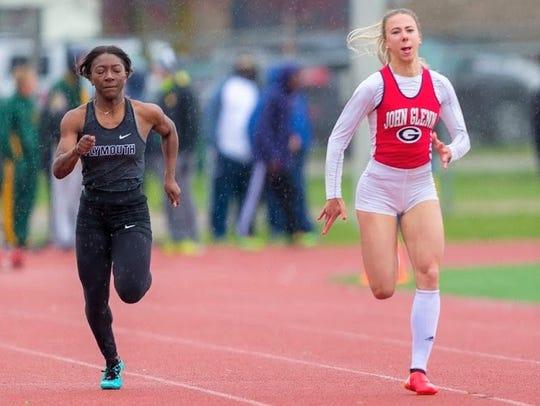John Glenn's Alona Olshevska (right) wins the 100-meter
