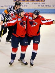 Rob Flick (left) celebrates making the Stingrays' 3rd goal in the 2nd period with teammate Wade Epp as South Carolina defeated the Florida Everblades 4-2 in Game 4 of their South Division Kelly Cup final series Wednesday, May 3, 2017 at the North Charleston Coliseum. South Carolina leads the best-of-seven series 3-1. Wade Spees/Staff