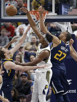 Indiana Pacers center Myles Turner (33) fights for a rebound with Utah Jazz center Rudy Gobert (27) in the first half of their game Tuesday, March 7, 2018, at Bankers Life Fieldhouse.