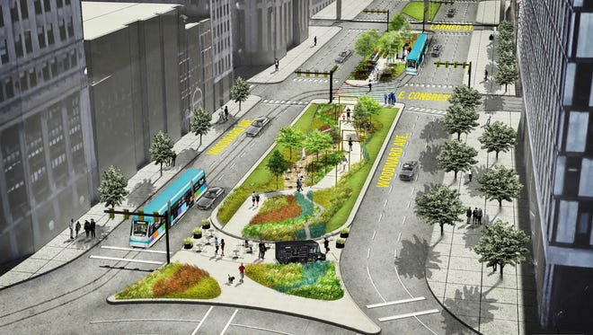 "Designed by the firm Groundswell, this rendering shows the new Woodward Avenue pathway or ""esplanade"" between Campus Martius Park and Larned."
