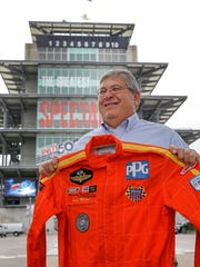 Steve Wissen shows the fire suit he wore the day Lazier nearly hit him in turn fourth following a crash in the 1992 Indianapolis 500. Lazier signed the suit Thursday, saying he was honored to do so.