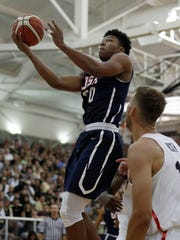Team USA's Nojel Eastern (20) puts up a shot on Team Canada's Erik Nissen (11) in the first half during the World University Games basketball game at Carmel High School Friday evening, August 11, 2017.