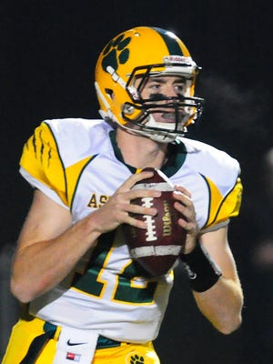 Ashwaubenon quarterback james Morgan in the WIAA Level 1 playoff game against De Pere at Goelz Field in Ashwaubenon, Friday, October 24, 2014.