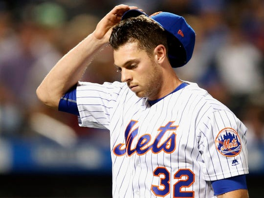 New York Mets starting pitcher Steven Matz leaves the field in the third inning of a baseball game against the Los Angeles Dodgers, Sunday, Aug. 6, 2017, in New York.