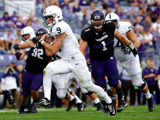 Penn State quarterback Trace McSorley (9) scores a touchdown by running during the second half of an NCAA college football game against Northwestern in Evanston, Ill., Saturday, Oct. 7, 2017. Penn State won 31-7. (AP Photo/Nam Y. Huh)