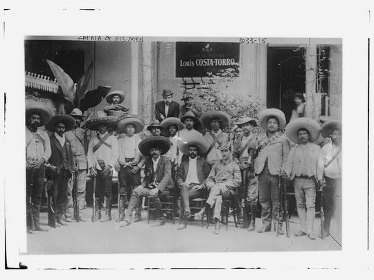 Emiliano Zapata, center, circa 1915, fought for land and agricultural reform during the Mexican Revolution.