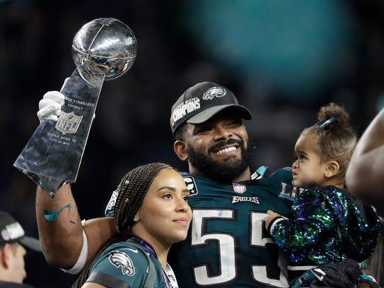 Eagles defensive end Brandon Graham holds up the Vince Lombardi Trophy after winning Super Bowl LII over the Patriots on Feb. 4.