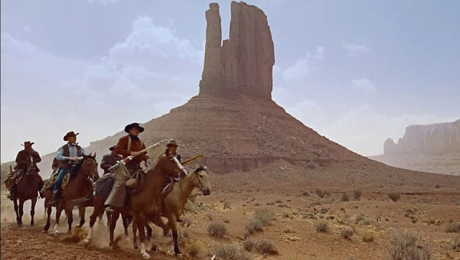 A scene from the 1956 John Ford western THE SEARCHERS, filmed at Monument Valley.  Credit: Warner Bros. Pictures.