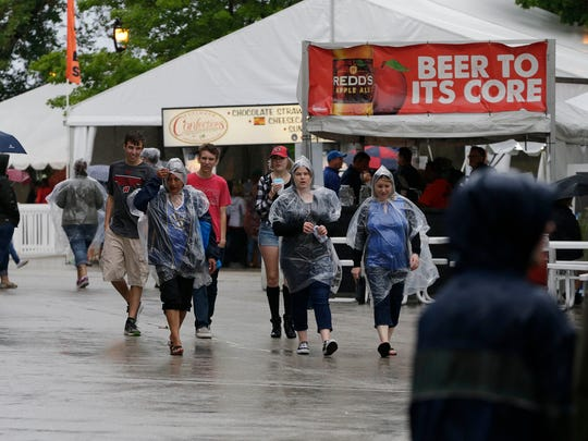 Rain didn't keep people away during the first day of  Summerfest , Wednesday, June 28, 2017 in  Milwaukee, Wisconsin.  Milwaukee Journal Sentinel photo by Rick Wood/RWOOD@JOURNALSENTINEL.COM ORG XMIT: 20092842A
