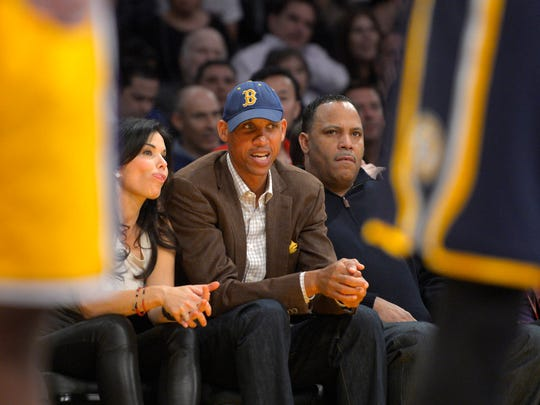 Former NBA play Reggie Miller watches the Los Angeles Lakers play the Indiana Pacers during the first half, Jan. 28, 2014, in  Los Angeles.