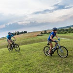 Mike Keefer of Hanover and daughter Olivia Keefer, 12, train on mountain bikes at West Manheim Recreation Park on Monday. The father-daughter duo have started a youth mountain biking team called the Hanover Area Youth Composite Team.