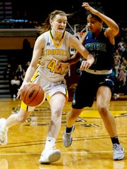 Grosse Pointe North's Julia Ayrault drives towards