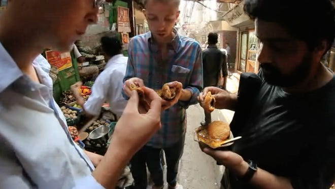"""From left, Grogan, Peach and Irani sample Indian street food in """"Cutting Chai."""""""
