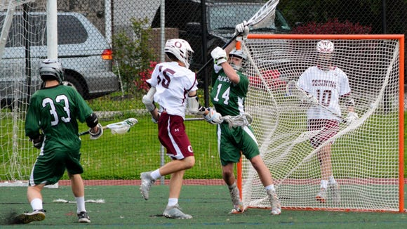 Ossining's John Turnquist scores past Brewster goalie