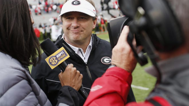FILE - In this April 20, 2019, file photo, Georgia coach Kirby Smart speaks with the media after an NCAA college football spring game in Athens, Ga. For the first time, the defending national champion Clemson Tigers are No. 1 in The Associated Press preseason Top 25 presented by Regions Bank, Monday, Aug. 19, 2019. Alabama is No. 2, Georgia is No. 3.