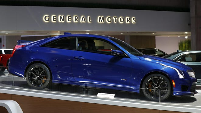 A Cadillac ATS V is shown in Detroit, Wednesday, Jan. 16, 2019. As General Motors undergoes a restructuring that will indefinitely idle four U.S. plants this year, the Detroit automaker plans to build more cars in America.