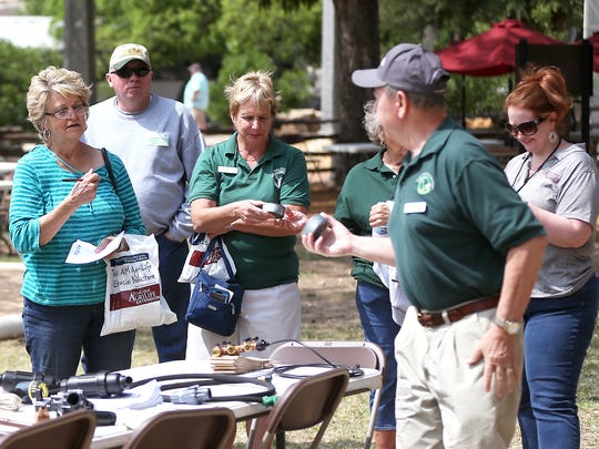 Residents listen to Ron Knight of the Concho Valley Master Gardeners discuss irrigation systems and parts during a water conservation seminar at the Bosque on Saturday, April 29, 2017.