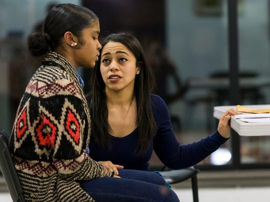 """Mia Mendez (right) and Elia Torres rehearse a scene from """"#BlackJobsMatter: A Wilmington Experiment"""" at the Chris White Gallery in Wilmington on Monday evening. The play is advocating for the creation of a new economic development tool in Delaware."""