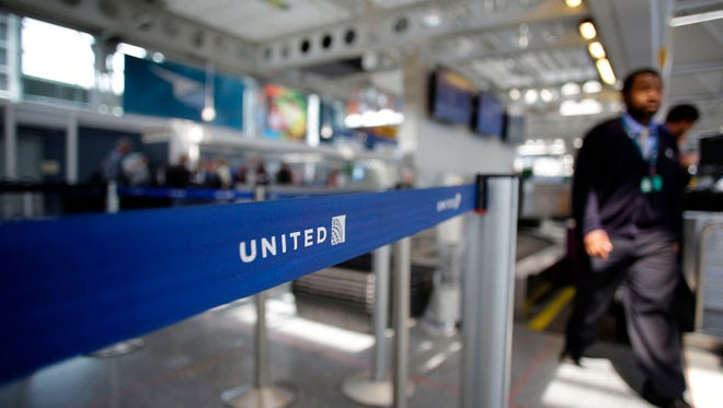 This file photo taken on April 12, 2017 shows an airport worker walking through the United Airlines terminal at O'Hare International Airport in Chicago, Illinois.