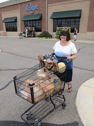 Sheri Bogetta said she liked the new Kroger store as she pushed her full basket of groceries to her car.