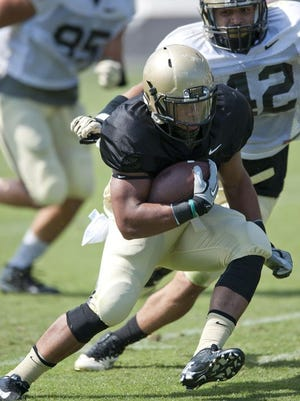 Freshman running back Markell Jones works his way through the defense during Purdue's Jersey Scrimmage on Saturday.
