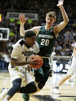 Johnny Hill with a baseline drive against Matt McQuaid of Michigan State Tuesday, February 9, 2016, at Mackey Arena. Purdue defeated Michigan State 82-81 OT.