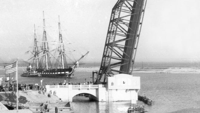 "The USS Constitution, Old Ironsides, approaches the bascule bridge as it leaves the port turning basin on Feb. 23, 1932 after a nine-day visit. The 1812 warship scraped the sides of the bascule bridge as it passed through when it arrived on Feb. 14, 1932. Photo by ""Doc"" McGregor."