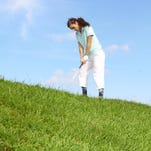 Golf tip: Properly hitting a downhill lie