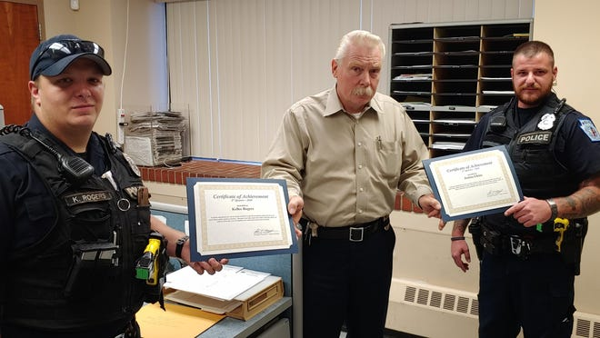 Waynesboro police officers, Kellee Rogers, left, and Joshua Elkins are pictured here with Waynesboro police chief Jim Sourbier III with their certificates. PROVIDED PHOTO