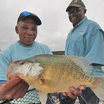 "Bernard Williams, left, and Don Terry, both of Jackson, use ""wildcat"" trolling for more crappie."