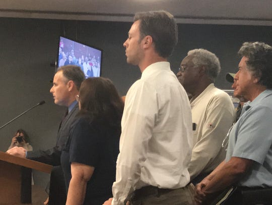 A group of recall supporters stands behind Aaron Starr, who told the Oxnard City Council he has enough signatures to recall four council members.