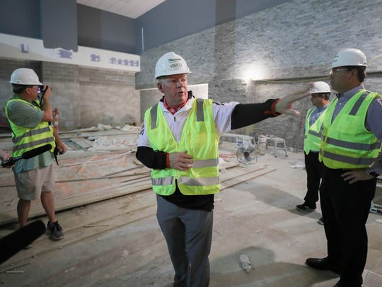 Bobby Petrino shows off the training room in the end zone expansion.