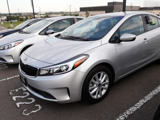 A used 2017 Kia Forte sits in a row of other used,
