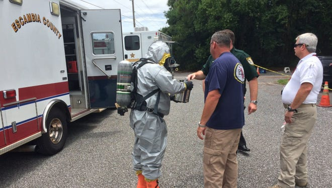 Emergency crews work to determine the danger of a white powder found at CHCS Services Inc. on Wednesday, August 9.