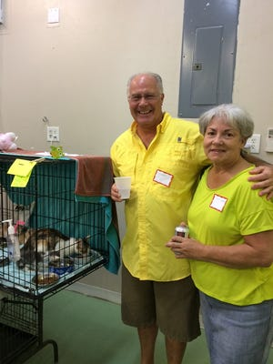 George and Lori Carden enjoy a moment with the cats during the volunteer appreciation party.