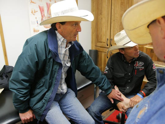 Dr. Bert Tardieu checks on a bull rider inside the Justin Boots Sports Medicine Team trailer during the 2015 Professional Bull Riding BlueDEF Velocity Tour Event on Wednesday at the Salinas Sports Complex.