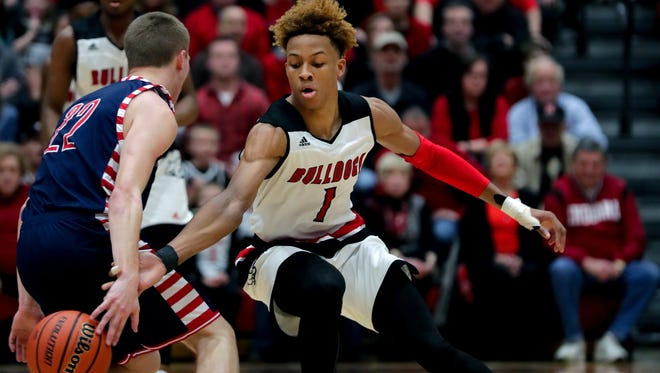 New Albany's Romeo Langford defends Bedford North Lawrence's Brayton Bailey.
