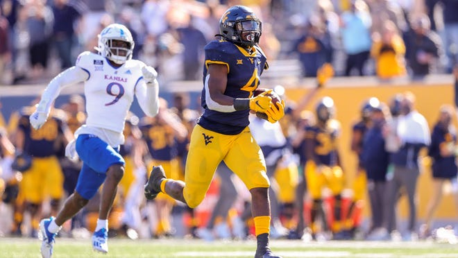 West Virginia's Leddie Brown (4) runs for a touchdown during an Oct. 17 game against Kansas in Morgantown, W. Va. Brown ranks 10th nationally with seven rushing touchdowns.
