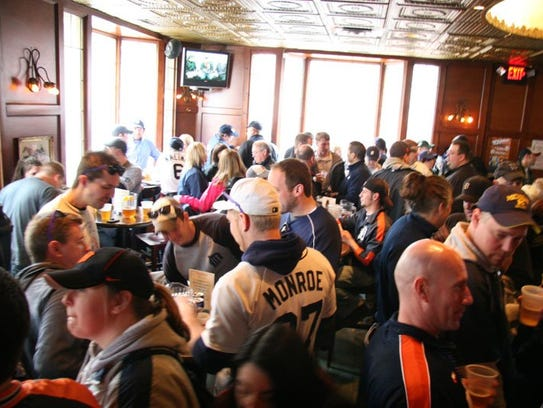 Tigers fans gather at the Town Pump for opening day