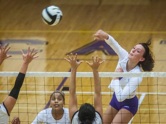 Central's Virgina Wilhoite hits for a point against