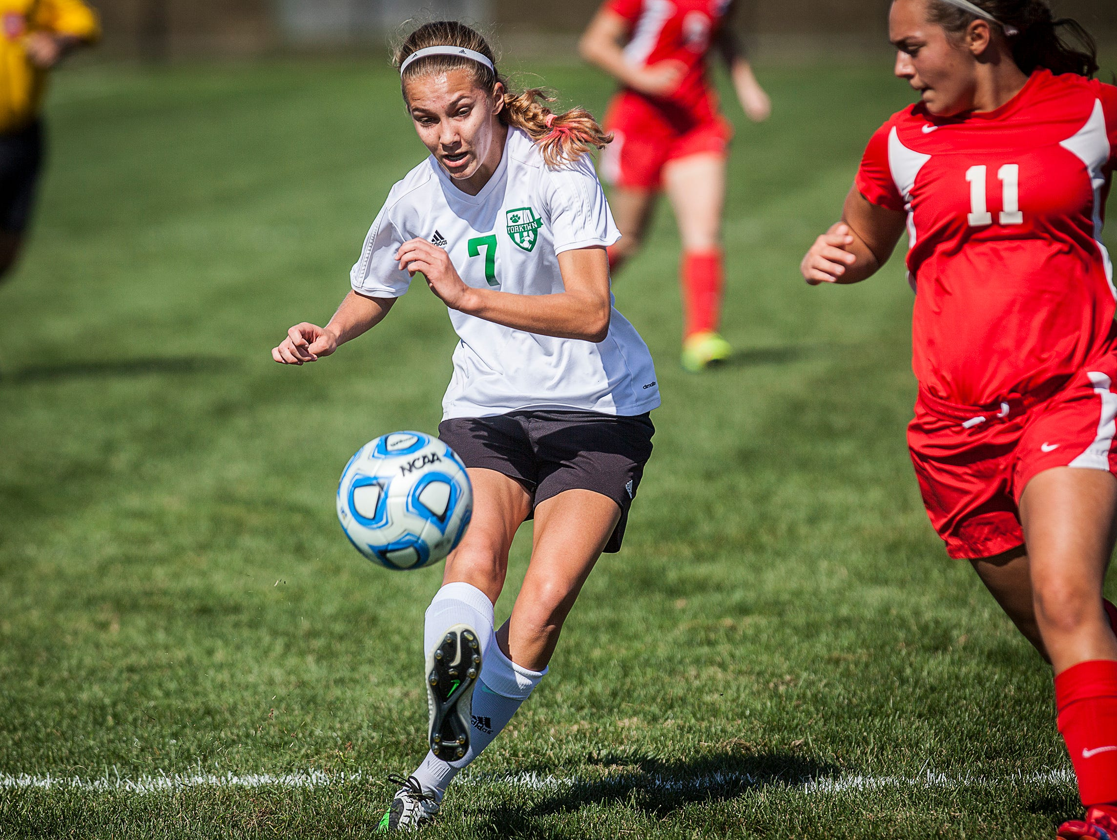 Yorktown's Hannah Rapp shoots past Jay County's defense during their game at the Yorktown Sports Park on Saturday, Oct. 10, 2015.