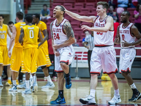 Ball State's Jeremiah Davis celebrates with Ryan Weber at the end of the second half of their game against Valparaiso at Worthen Arena Saturday, Nov. 28, 2015.