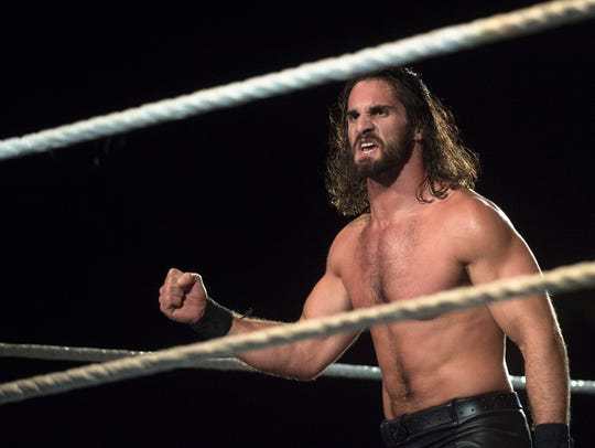 Seth Rollins pumps his fist after beating Rusev during